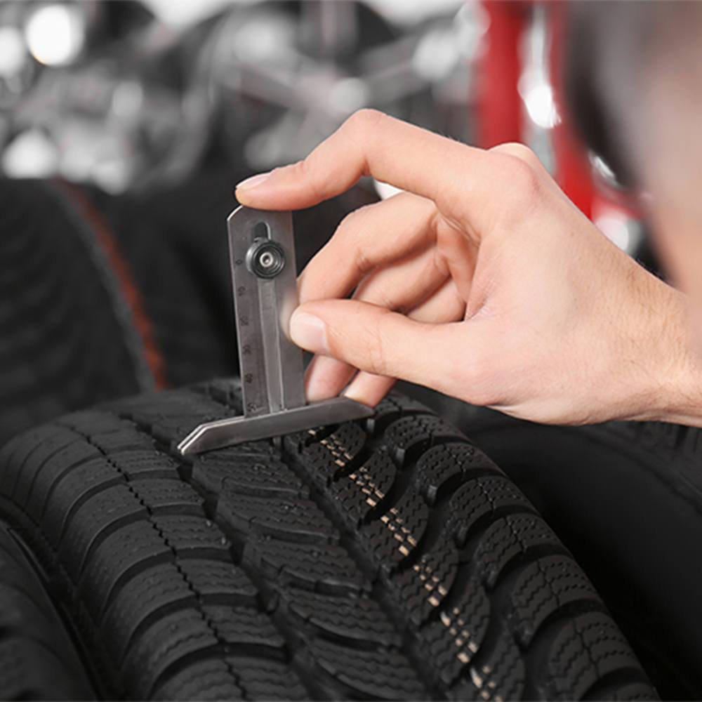 How does tyre tread depth affect grip